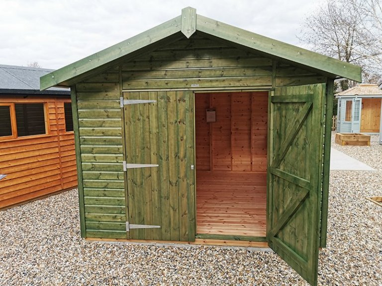 Sevenoaks' 3.0 x 3.6m Superior Shed Treated with a Green Sikkens Wood Stain
