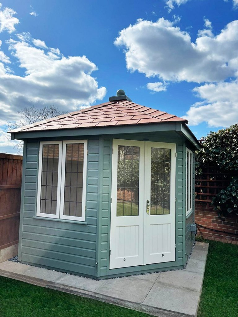 2.4 x 2.4m Weybourne Summerhouse in Exterior Sage Paint with Ivory Doors and Windows