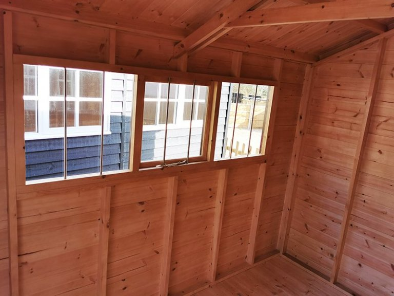 Interior of Sevenoaks' 2.4 x 3.0m Superior Shed in Sikkens Walnut