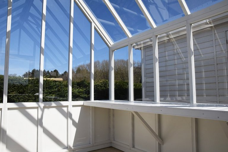 Inside Narford's 2.4 x 3.0m Greenhouse in Exterior Ivory Paint