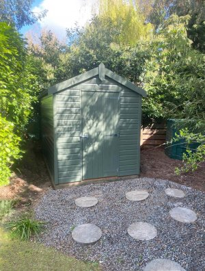 1.8 x 3.0m Classic Shed painted in Classic Moss with apex roof design