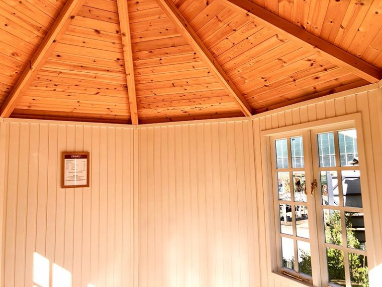Interior of the 3.0 x 3.0m Wiveton Summerhouse at Cranleigh in Exterior Lizard Paint