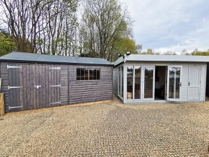 A Superior Shed and a Salthouse at our Tunbridge Wells show centre with the Shed treated with a Grey Sikkens Wood Stain and the Salthouse painted in Pebble