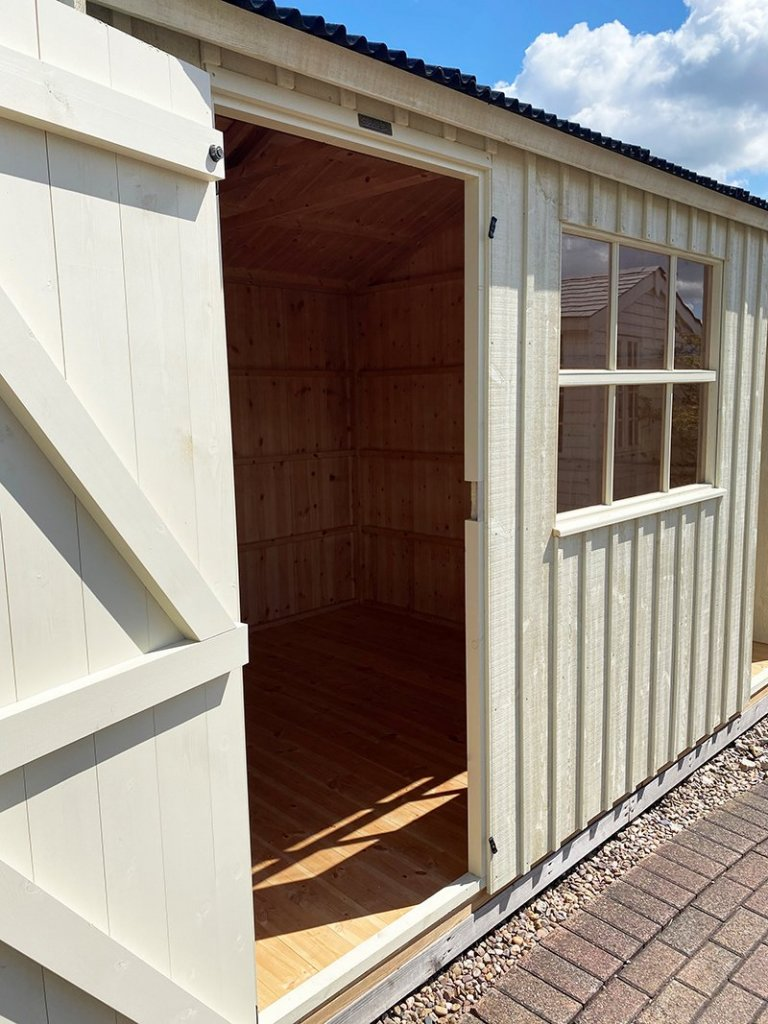 Close up of Nottingham's 2.4 x 3.6m Blickling National Trust Shed painted in Dome Ochre