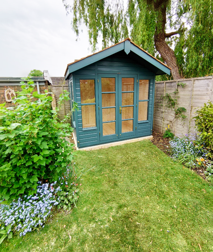 2.4 x 1.8m Blakeney Summerhouse in Exterior Slate Paint with cedar shingles on the roof