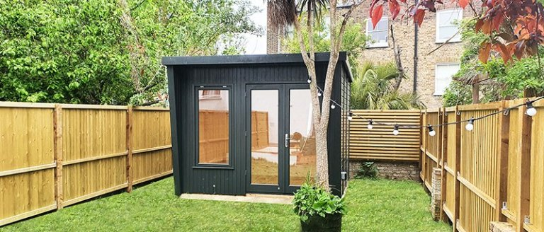 2.4 x 3.0m Classic Office painted in Coal with stylish pent roof design