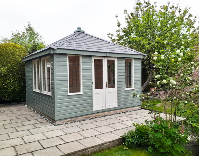 3.6 x 3.6m Cley Summerhouse in Exterior Sage & Cream with grey slate effect roof tiles