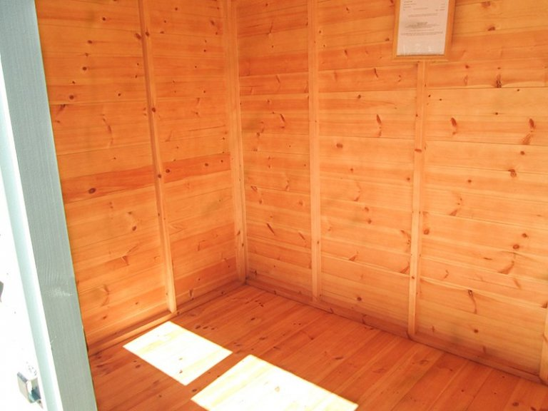 Inside Sunningdale's 1.8 x 2.4m Classic Shed painted in Seagrass with pent roof design