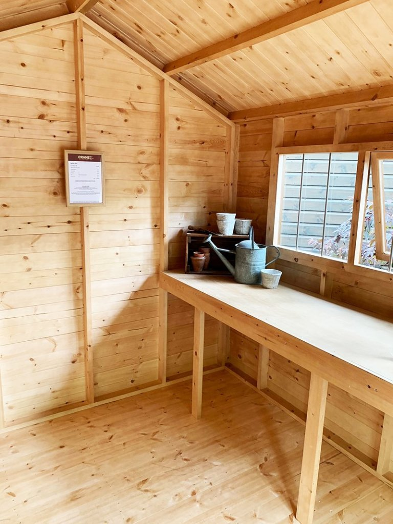 Inside Trentham's 2.4 x 3.0m Superior Shed treated in Sikkens Walnut