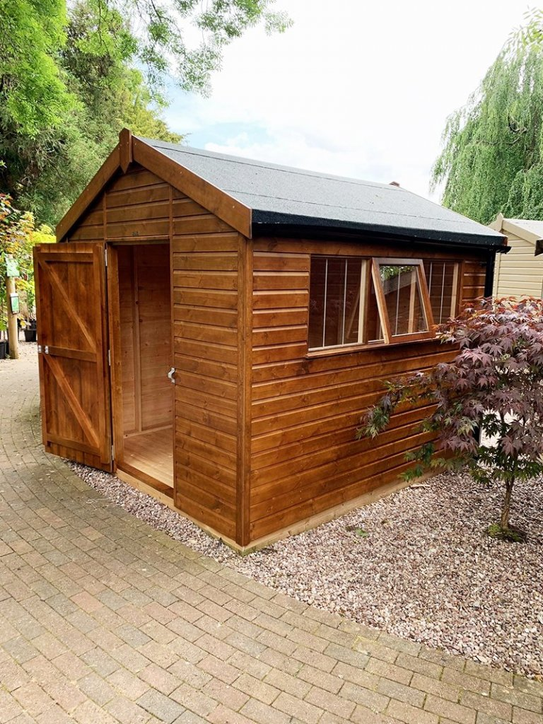 Trentham's 2.4 x 3.0m Superior Shed treated in Sikkens Walnut