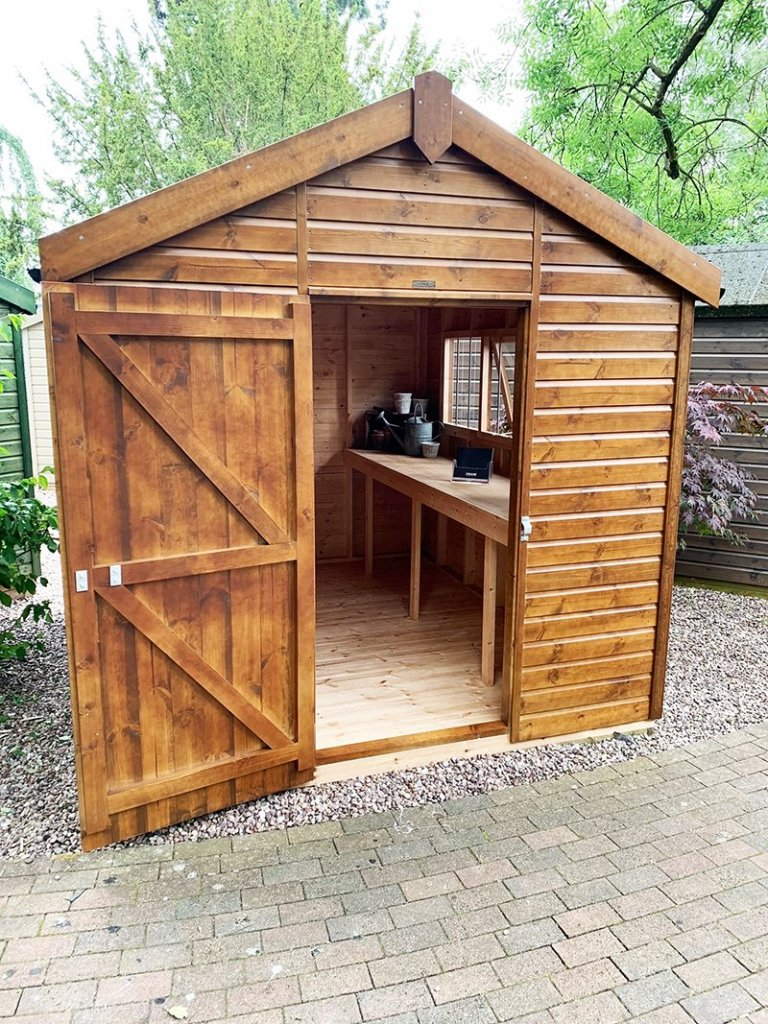 2.4 x 3.0m Superior Shed at Trentham treated in Sikkens Walnut