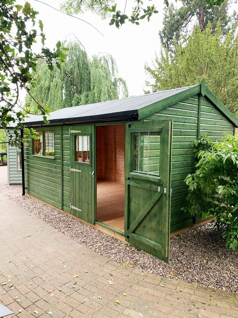 Trentham's 3.0 x 4.8m Superior Shed treated with a Green Sikkens wood stain