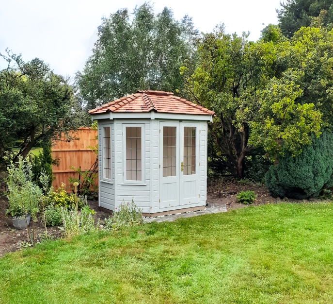 1.8 x 2.5m Wiveton Summerhouse painted in Exterior Verdigris with cedar shingles on the roof and leaded windows