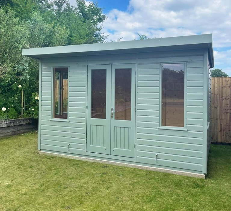 2.4 x 3.6m Thornham Summerhouse painted in Exterior Sage with pent roof design