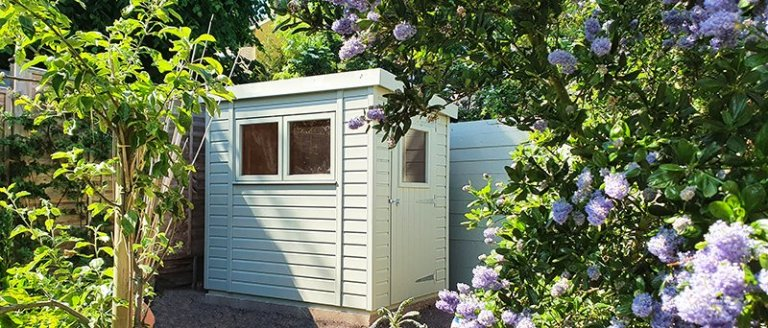 1.5 x 2.1m Superior Shed painted in Exterior Lizard with pent roof design