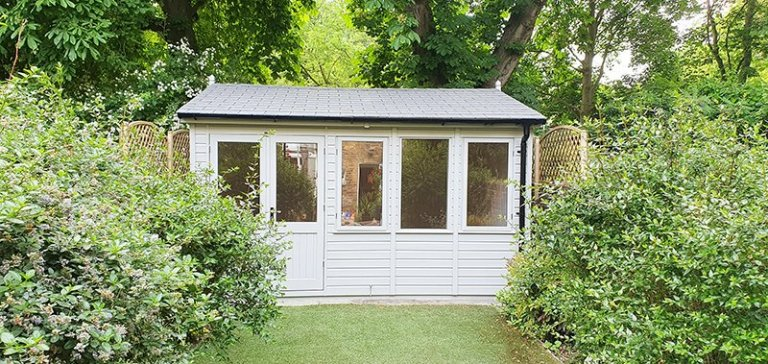 4.2 x 4.2m Langham Studio painted in Exterior Pebble with grey slate effect roof tiles