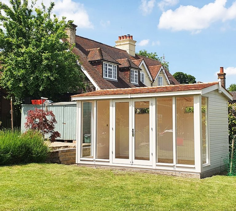 2.4 x 4.2m Burnham Studio painted in Exterior Twine with cedar shingles on the roof