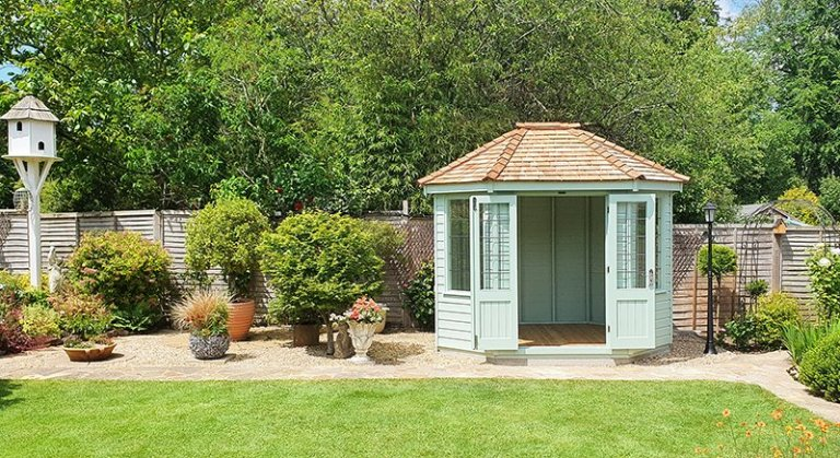 2.4 x 3.0m Classic Summerhouse painted inside and out with Classic Seagrass, with cedar shingles on the roof