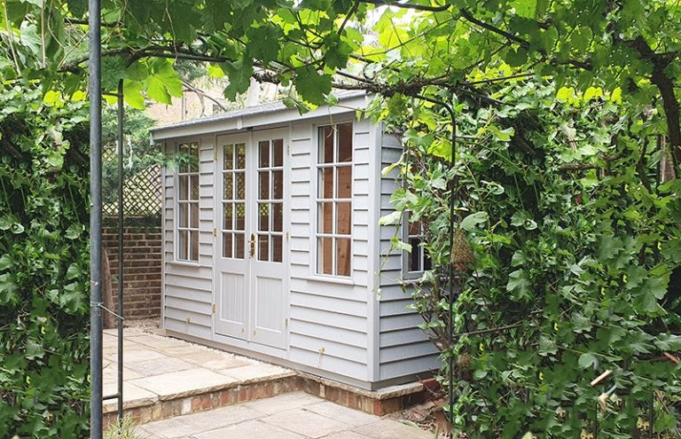 2.4 x 3.0m Holkham Summerhouse painted in Farrow & Ball Manor House Gray with grey slate effect tiles on the roof
