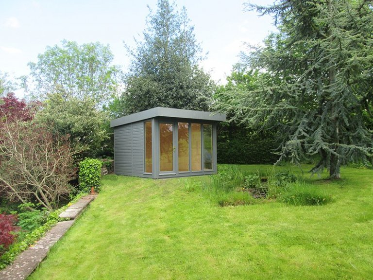2.4 x 3.0m Salthouse Studio painted in Exterior Slate with natural matchboard interior