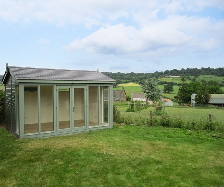 3.0 x 4.2m Burnham Studio painted in Exterior Sage with grey slate effect tiles on the roof