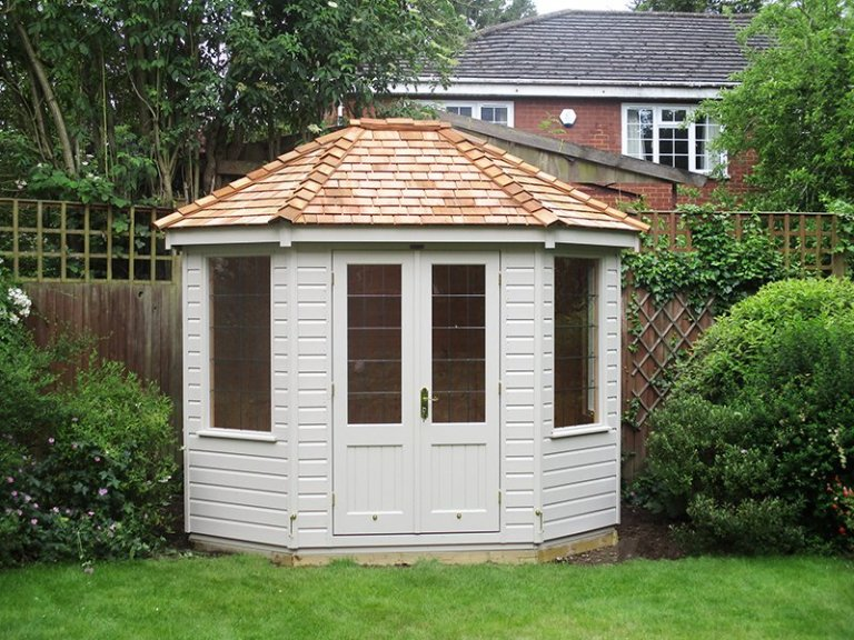 2.4 x 3.0m Classic Summerhouse painted in Classic Cotton with leaded windows