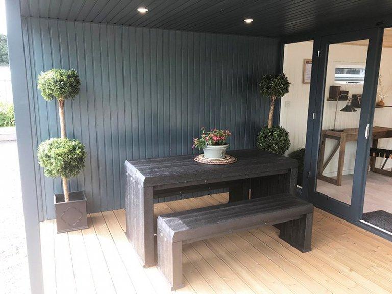 The extended veranda on Nottingham's 3.6 x 6.0m Holt Studio in Exterior Slate