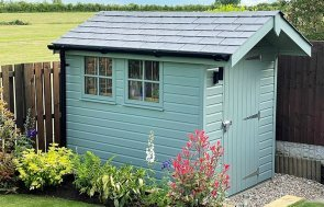 1.8 x 2.4m Superior Shed painted in Exterior Sage being used as an air craft scale modelling room