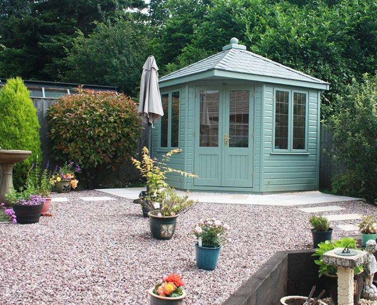 2.4 x 2.4m Weybourne Summerhouse painted in Exterior Sage with leaded windows and grey slate effect roof tiles