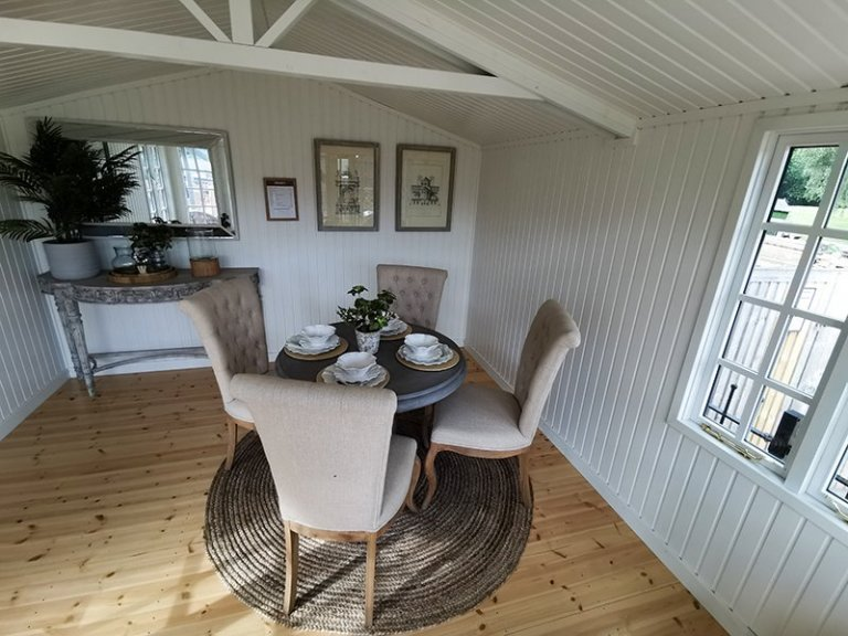 Inside a 3.6 x 4.8m Morston Summerhouse with Ivory painted walls and ceiling