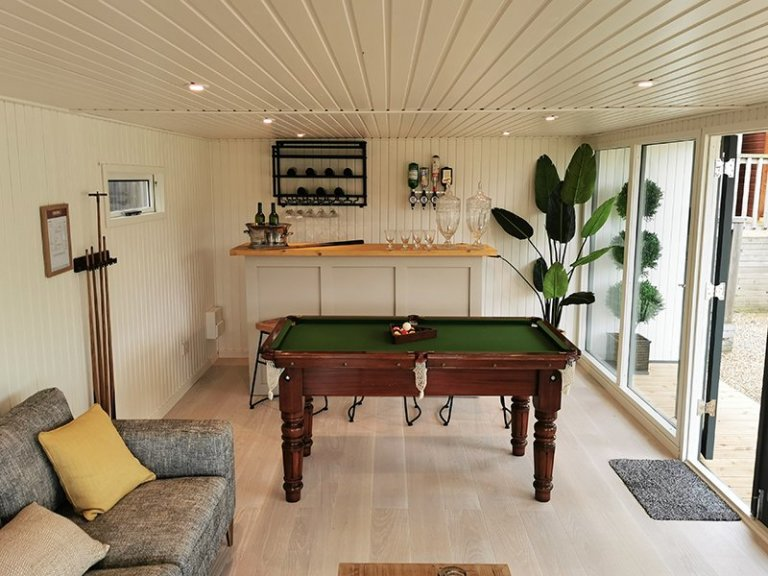 Games Room setup inside a 4.6 x 9.0m Holt Studio, with the walls and ceiling lined with Farrow & Ball Pointing painted matchboard and Copenhagen engineered flooring