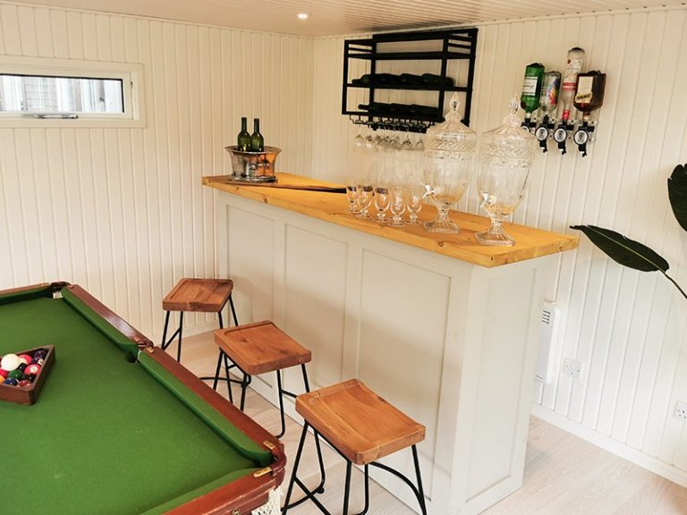 Garden Bar inside a 4.6 x 9.0m Holt Studio, with the walls and ceiling lined with Farrow & Ball Pointing painted matchboard and Copenhagen engineered flooring