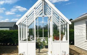 Narford's 2.4 x 3.0m Greenhouse painted in Exterior Ivory filled with plants