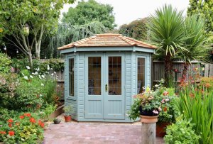 1.8 x 2.5m Wiveton Summerhouse painted in Exterior Sage with leaded windows
