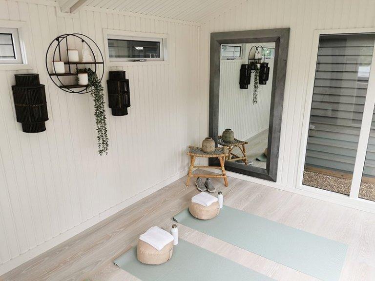 Inside Tunbridge Wells' 3.0 x 4.2m Burnham Studio painted in Exterior Verdigris setup as a yoga room
