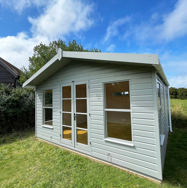 4.2 x 3.6m Blakeney Summerhouse painted in Exterior Pebble with opening fanlight window in the back wall