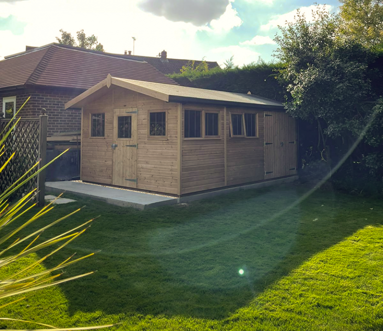 3.6 x 5.4m Superior Shed treated with a Light Oak Preservative, with an apex roof design