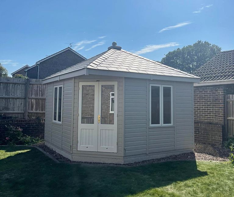 3.6 x 3.6m Weybourne Summerhouse painted in Exterior Twine & Ivory with grey slate effect tiles on the roof
