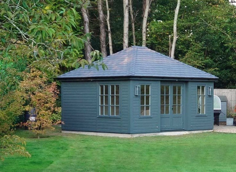 4.2 x 4.8m Garden Room painted in Farrow & Ball Down Pipe with Grey Slate Effect Tiles Covering the Hipped Roof and Georgian Windows