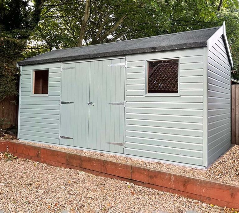 2.4 x 4.8m Superior Shed painted in Exterior Sage with apex roof design