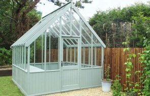Greenhouse painted in Exterior Sage with selection of potted plants outside