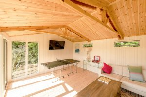Burnham Studio Interior with table tennis table and comfy sofa